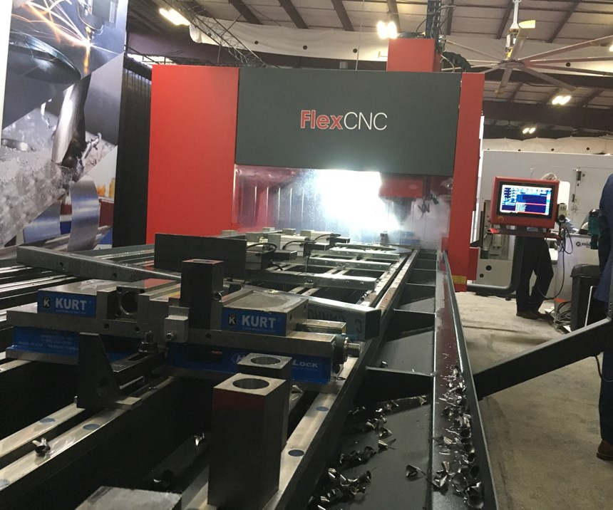 Displayed at Eastec, a large machine from Flexarm CNC has multiple jobs mounted within its workzone.