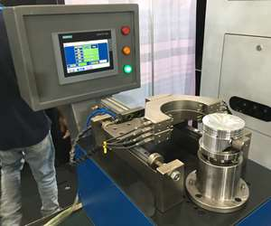 A SmartCorrect gaging station uses a rotating turntable fixture and digital probes to check profile accuracy and find the point of maximum ovality on the circumference of an engine piston