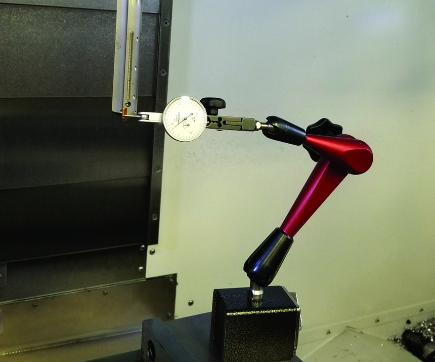 A complicated indicator setup illustrates the difficulty and time expenditure associated with measuring tools already mounted in the machine tool.