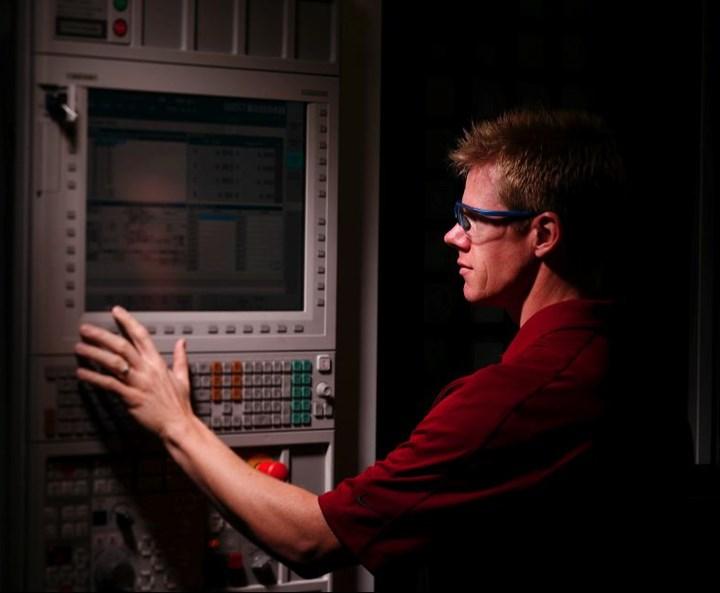 man at CNC