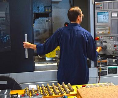 skilled machining employee at Designatronics