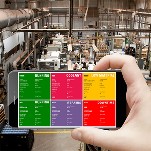 A cell phone display of utilization metrics demonstrates the remote machine monitoring capability of a system like Scytec's DataXChange.