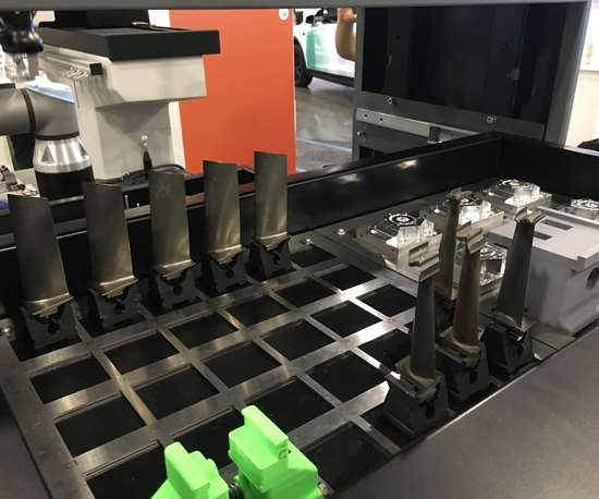 3D-printed holders facilitate CMM loading automation by allowing the robot to grip either the part itself or the holder.