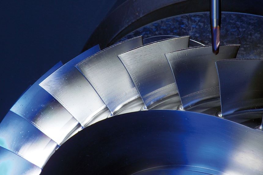 A milling tool moves to engage the fan-like blade of a bladed disk, or blisk, during CNC machining operations that leverage 5G to compensate for chatter (a form of vibration) in near real time.