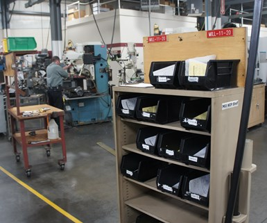 Black bins hold work-in-process (WIP) at Ohio machine shop Northwood Industries.
