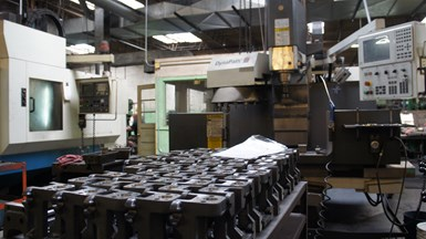 An array of vises is pictured in a box at Heinrich vise, a co-located sister company of high-volume sheet-metal stamper Ace Stamping & Machine Co. in Racine, Wisc.