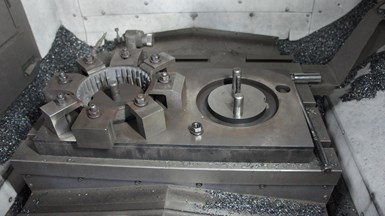 A grind ring casting fixture is all set up on an Okuma MB-46 CNC vertical machining center at Ace Stamping & Machine Co., a high-volume metal stamper in Racine, Wisconsin.