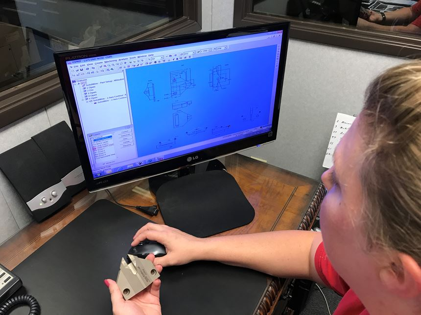 programmer using Esprit on a computer