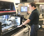 shop owner operating Mitsubishi MVR1200-R wire EDM