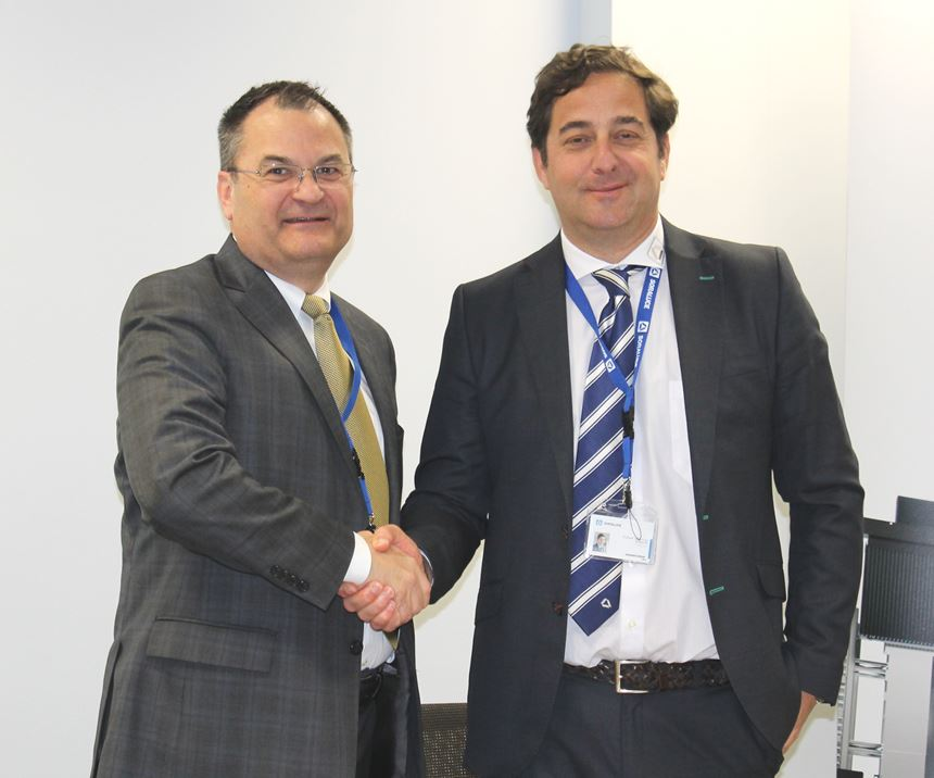 Rafael Idigoras, Managing Director of Soraluce (right) and Chris Stine, Exec. Vice President of Morris Group