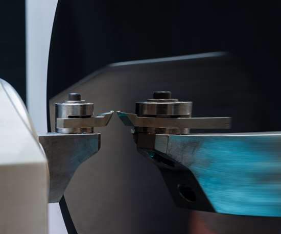 A closer look at the mirror-cutting CNC machining operation reveals a mono-crystalline diamond turning insert.