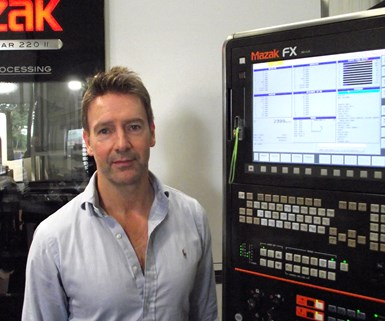 Simon Watson with a Mazak Fabri Gear II laser tube cutting machine