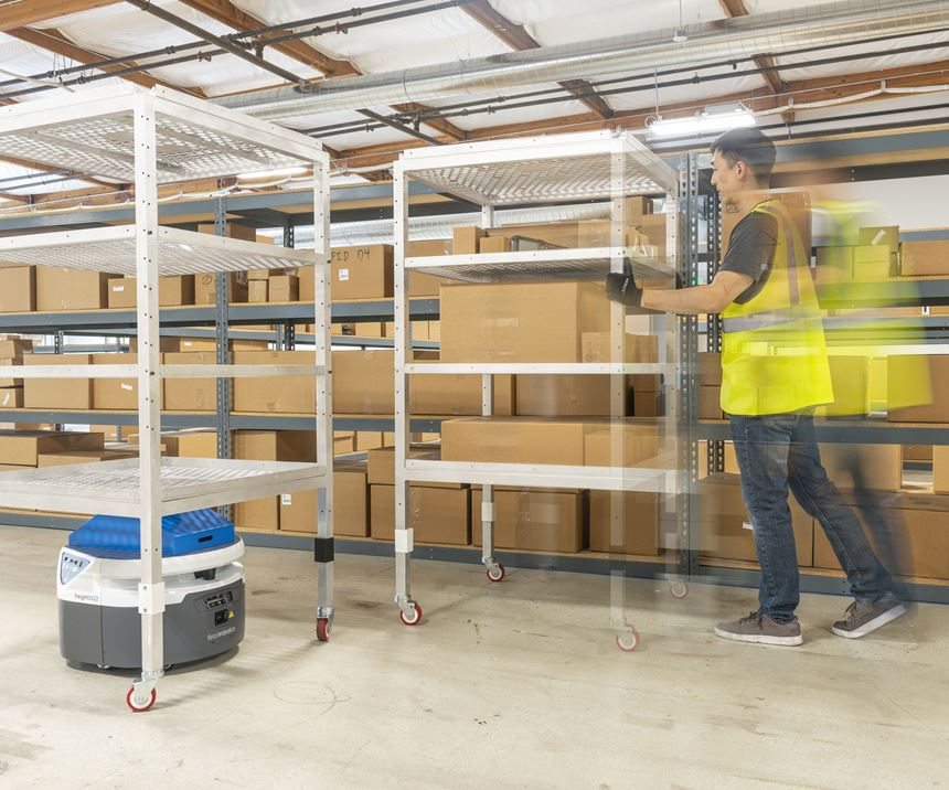An automated mobile robot (AMR) uses 3d vision and machine learning to navigate in a more natural manner past a person moving a cart in a warehouse aisle.