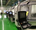 A line of robot-tended Ewag Compact tool grinders from United Grinding evidences Tool-Flo's focus on automation.