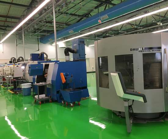A line of machining centers, including a DMG Mori DMU 80 T, is used to machine tool bodies at Tool-Flo's new indexable cutting tool manufacturing plant in Houston.