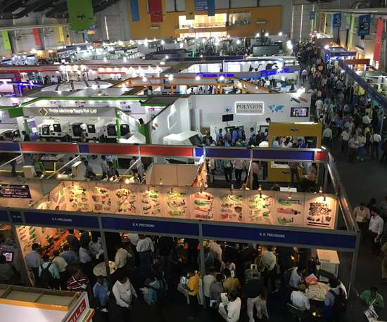 The halls of the IMTEX metal-cutting exhibition crowd with attendees.