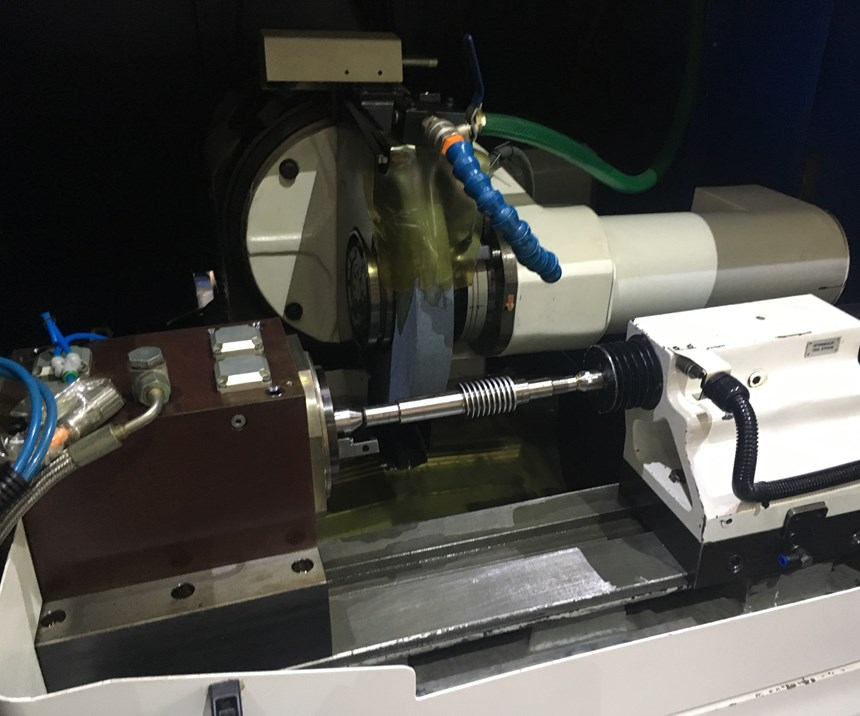 A profiled shaft undergoes machining on a jig grinder developed by UCAMM to better control the manufacture of its rotary machine tool accessories.