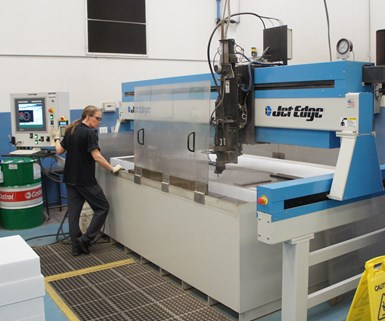 A large waterjet performs 2D cutting at composites manufacturer DeltaWing.