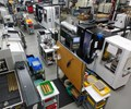 bar-fed multitasking CNC lathes and bar-fed five-axis machining centers