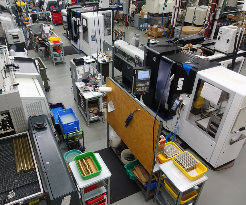 Willemin-Macodel machining center with robot visible through window