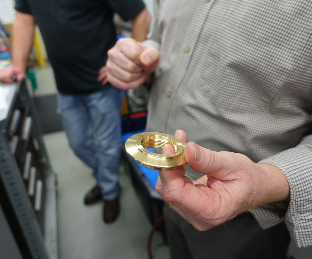 Unloading this soft brass part after machining is challenge