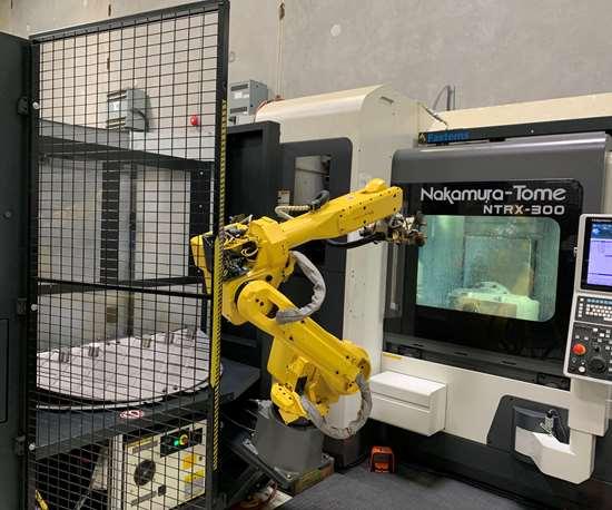 robot tending a Nakamura-Tome NTRX-300