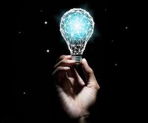 brainstorming man holding lightbulb