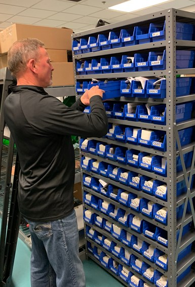 Evco employee retrieving 3D printed inspection fixtures