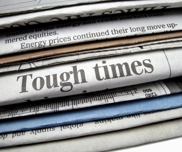 "newspaper headline reads ""Tough Times"""