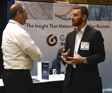 Michael Guckes talks to an attendee
