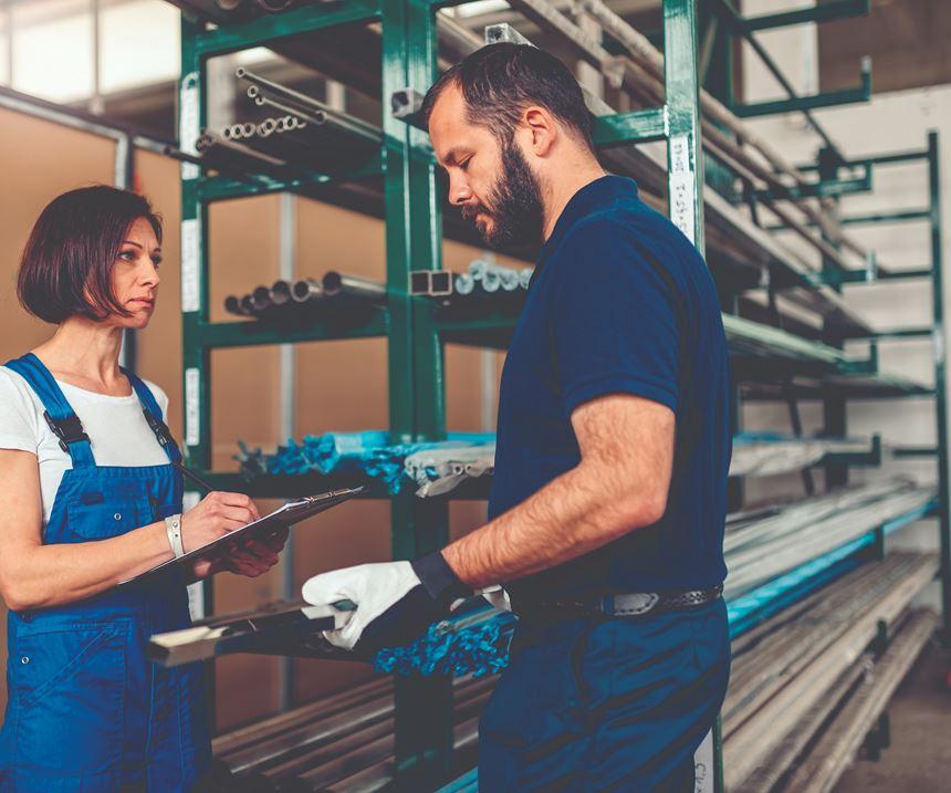 warehouse employees handing off work