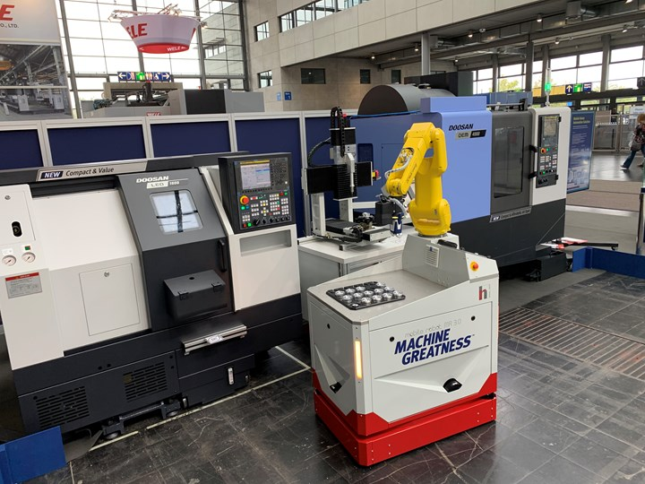 The independent robot here carries parts through the stations of a cell that includes machining center, lathe, and inspection