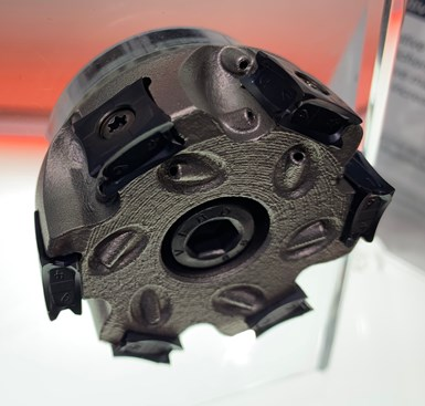 This milling cutter body from LMT made via additive manufacturing features curving and branching internal channels to deliver coolant flow precisely where needed