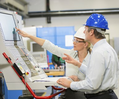 stock photo of two manufacturing leaders on the shop floor
