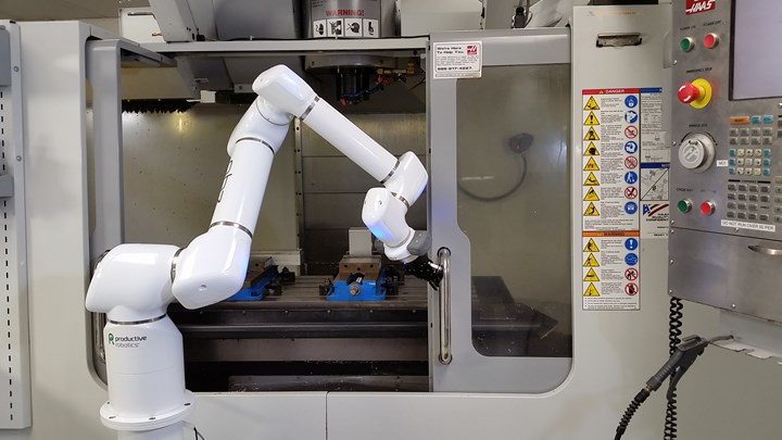 An OB7 collaborative robot from Productive Robotics opens the door of a CNC machine tool.
