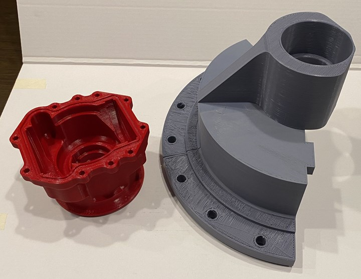 Examples of 3D-printed prototype parts are laid out on a table  at Advanced Precision Engineering (APE).