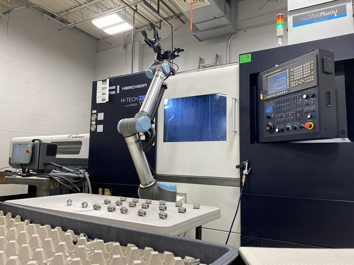 A UR10 collaborative robot from Universal Robotics loads and unloads a Hwacheon CNC machine at Advanced Precision Engineering (APE).