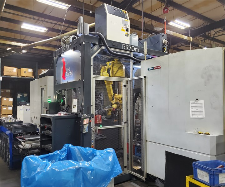 "Red Rabbit's ""redeployable robot,"" a self-contained automation system, tends machine tools on the shop floor at Vickers Engineering."