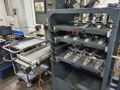 A system of drawers with custom-machined slots for workpieces holds automotive brackets for loading into machine tools at Vickers Engineering.