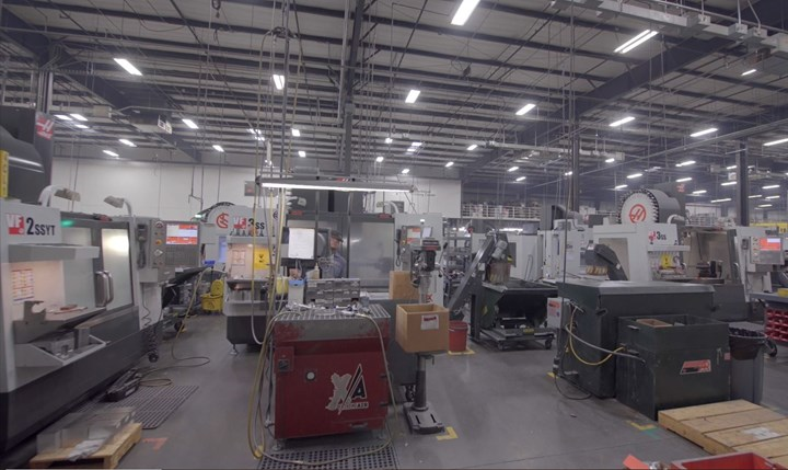 Haas VMCs and robots are visible on the shop floor at Cox Machine, an aerospace machine shop in Wichita, Kansas.