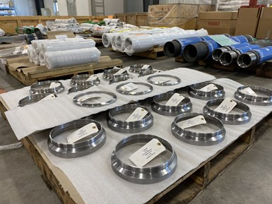 Parts sit on pallets at oilfield manufacturer Superior Completion Services.