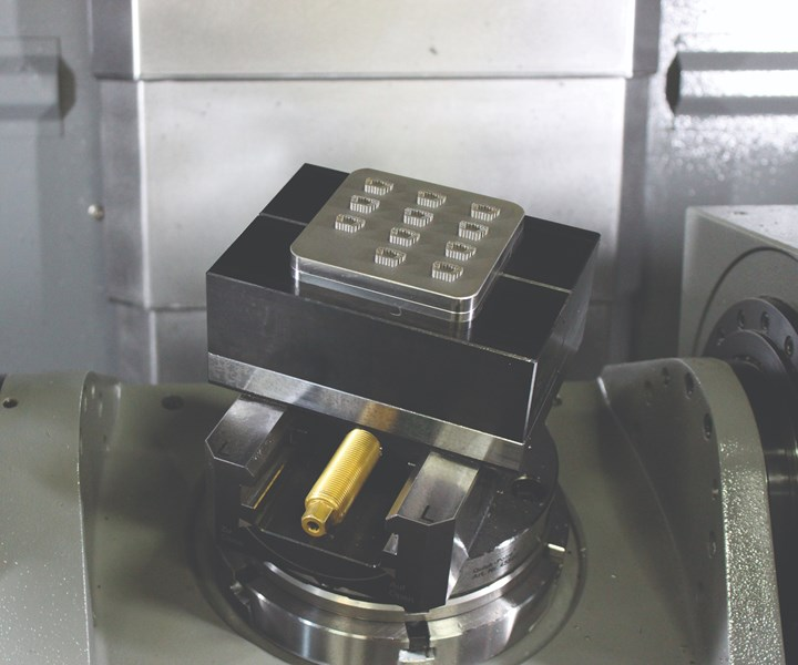 Here are 3D printed spine implants set up in the five-axis machining center, prior to their being cut off of the additive manufacturing build plate.