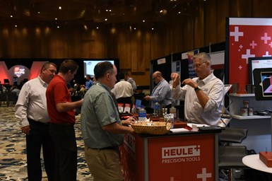 Attendees gather at a booth during the 2019 Top Shops Conference.