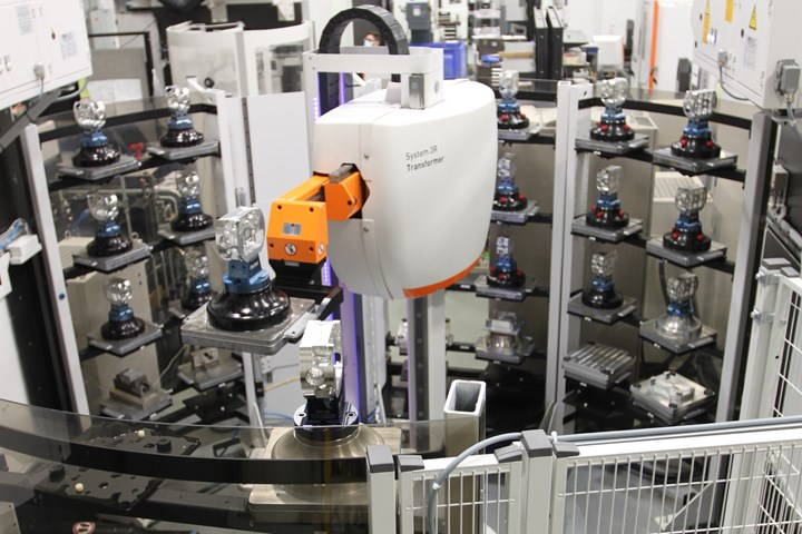APE's new five-axis machining cell contains four machines serviced by central robot.