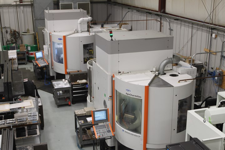 Five-axis machine tools on the shop floor at Advanced Precision Engineering (APE), a CNC machining business in Ipswich, Mass.