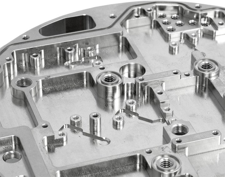 A close-up of an intricate chassis produced on a CNC machining center at Pacon mfg, Inc.