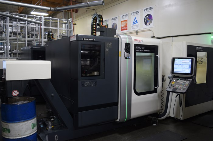 A metal part undergoes CNC operations on a Makino A500Z five-axis machining center.