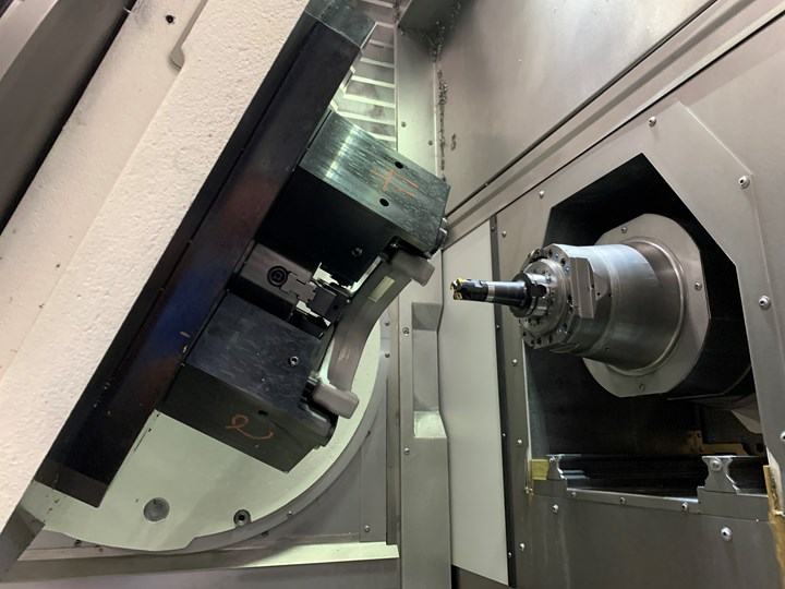 An inside view of a Grob G550 five-axis machining center reveals a tilting table and retractable spindle.