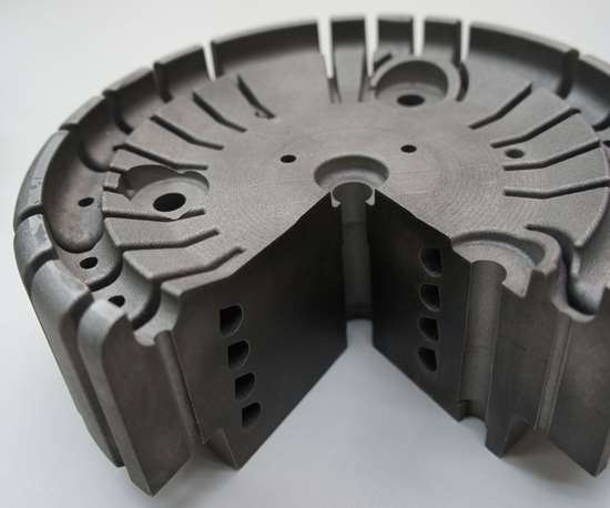 A mold insert produced via additive manufacturing is impregnated with 3D-printed conformal cooling channels.