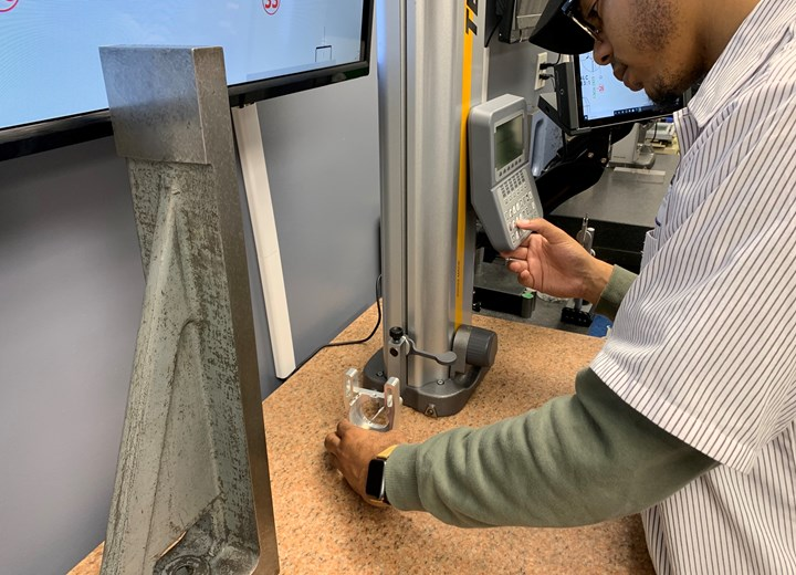 An employee works with a CMM at Marzilli Machine Co.
